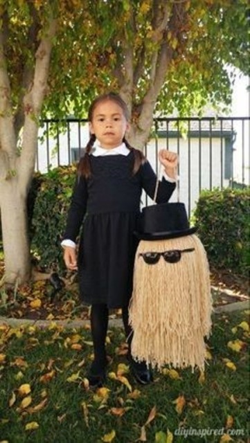 Child dressed as wednesday addams from the addams family