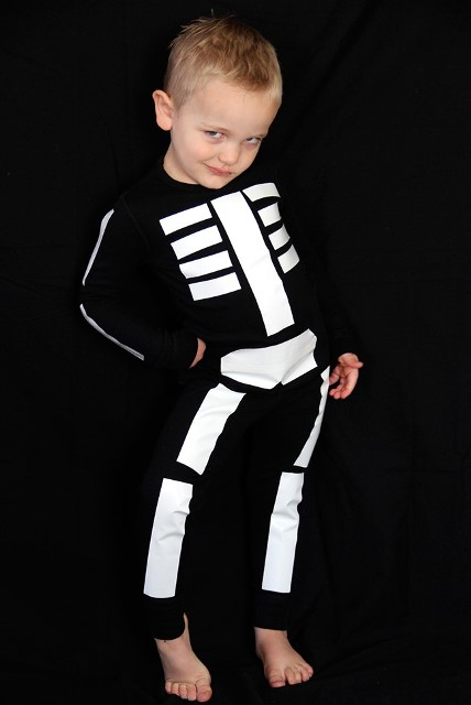 child dressed as a skeleton for halloween